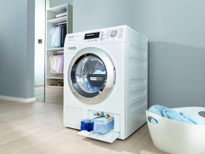 Miele aduce în România mașina de spălat rufe cu uscător încorporat și dozare automată a detergentului